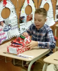 Student opening Holiday Gifts