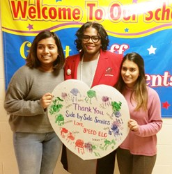 Three people holding Thank You Sign